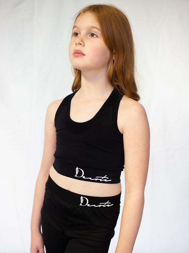 black crop top, black shorts